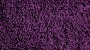 beautiful mingle colored bath rug in a shag style with deep dark and medium tone purple colors