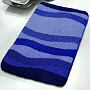 affordable wave patterned low pile bath rugs in blue, green or red