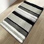 striped bath rug with grey, black and white stripes