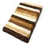 plush striped multi color bath rug in beige, orange, blue or green