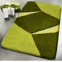 geometric bath rug design with multi dimensional pile height in red, green or purple